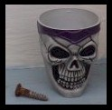 Skull shotglass. This also came in beige-and-red, but I coudln't find it at the time I was taking pictures. Screw is there for size comparison.